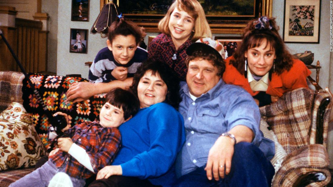"""Roseanne"" premiered in October 1988 and focused on a working-class family in Illinois. Barr played the plainspoken matriarch Roseanne Connors. Her husband was played by John Goodman."