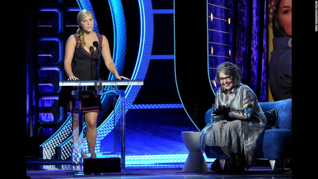 Barr is roasted by Amy Schumer, left, and others during a Comedy Central special in August 2012.