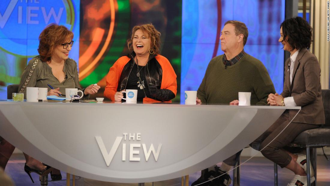 "Barr, Goodman and ""Roseanne"" co-star Sara Gilbert, right, appear on ABC's ""The View"" to promote their show in March 2018."
