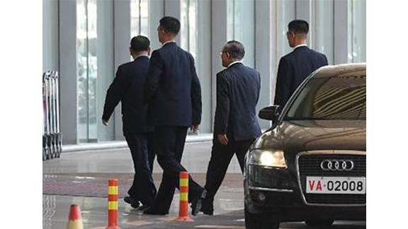 Top North Korean official Kim Yong Chol (far left) arrives at Beijing International Airport on Wednesday afternoon, local time.
