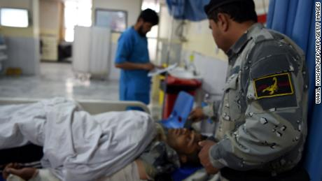 A wounded Afghan policeman receives treatment at a hospital after the attack on the Interior Ministry in Kabul.