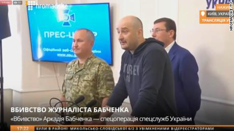 Babchenko (center) appears at a news conference Wednesday afternoon.