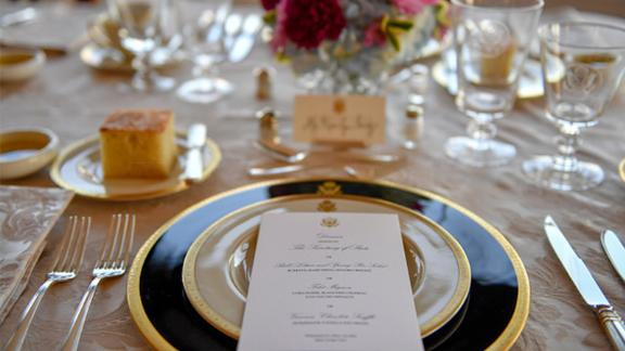 The official dinner menu featured traditional American staples such as beef and corn.
