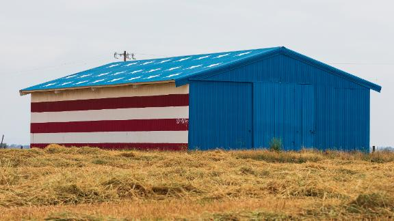 Barn painted in Red, White and Blue American Flag colors on Friday, May 4, 2018 outside of Fresno, Calif. (Ric Tapia via AP)