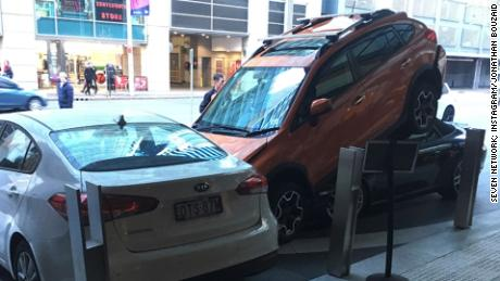 NS Slug: AUSTRALIA: WITNESSES OF THE PORSCHE CRASHING  Synopsis: A valet worker in Syndey parked a Porsche under another car on Thursday morning.  Video Shows: - Stills of a Porsche under another car - Two witnesses     Keywords: PORSCHE SYDNEY AUSTRALIA VALET CARS