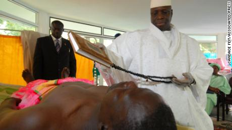Gambian President Yahya Jammeh prays when he administered his alleged herbal HIV treatment to a patient at the Banjul State House on February 15, 2007.