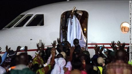 Ex-president Yahyah Jammeh waves to a group of supporters before leaving the country at Banjul International Airport on January 21, 2017. Jammeh was beaten by current President Adama Barrow and ended his 22-year reign.