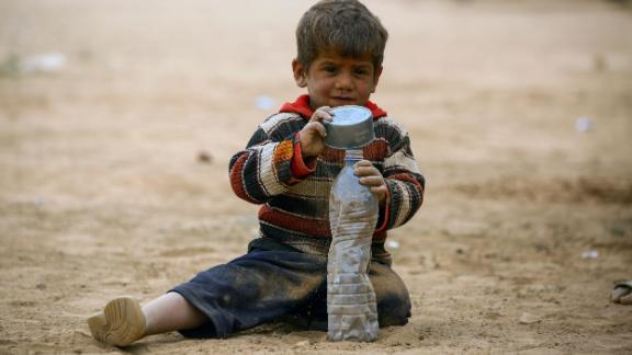 A displaced Syrian child at a temporary camp in the village of Ain Issa on April 28, 2017.
