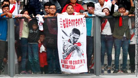 Fans of Peru display a banner in support of Paolo Guerrero.