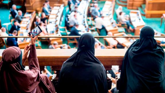 Women wearing niqab sit in the audience at the Danish Parliament in Copenhagen on Thursday.