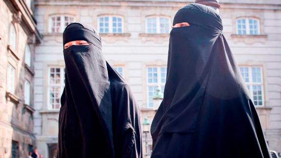 Women wearing niqab are pictured in front of the Danish Parliament in Copenhagen, Denmark, on May 31, 2018. - The Danish parliament on Thursday, May 31,2018, passed a law banning the Islamic full-face veil in public spaces, becoming the latest European country to do so. (Photo by Mads Claus Rasmussen / Ritzau Scanpix / AFP) / Denmark OUT        (Photo credit should read MADS CLAUS RASMUSSEN/AFP/Getty Images)