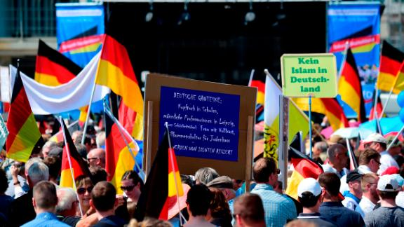 "At an AfD rally on May 27,  supporters hold placards reading ""No Islam in Germany."""