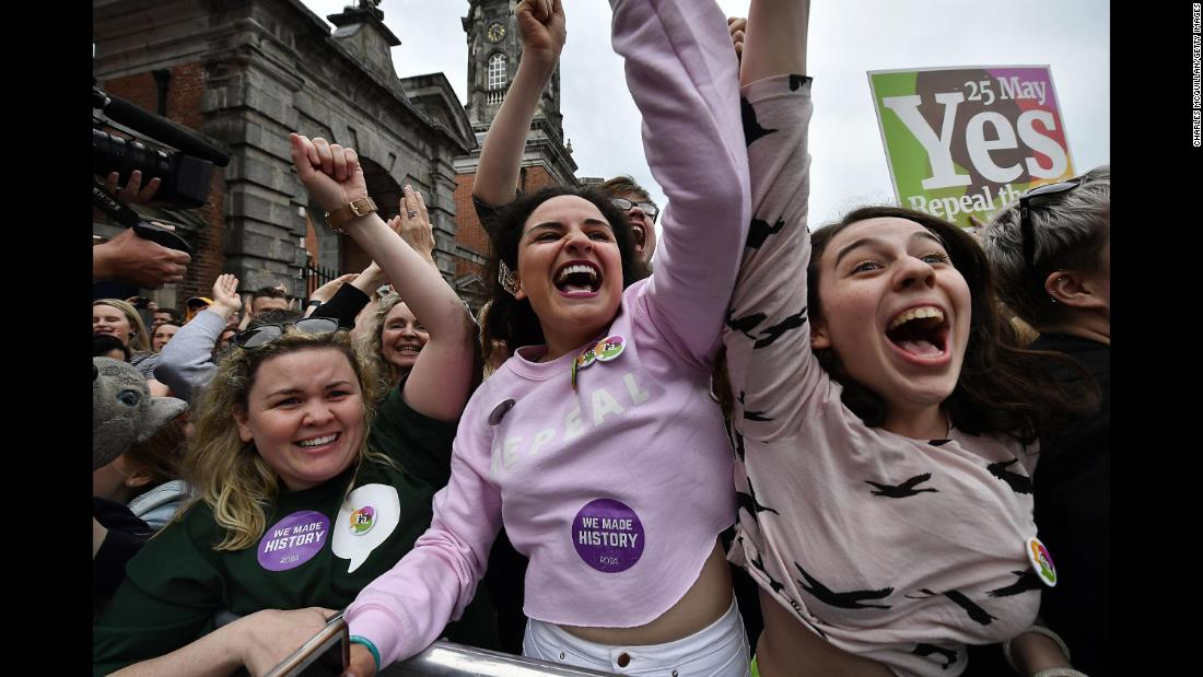 "People celebrate at Ireland's Dublin Castle on Saturday, May 26, after it was announced that voters in the country had decided <a href=""https://www.cnn.com/2018/05/26/europe/ireland-count-abortion---intl/index.html"" target=""_blank"">to repeal the Eighth Amendment,</a> which bans abortion unless there is a ""real and substantial risk"" to the mother's life."