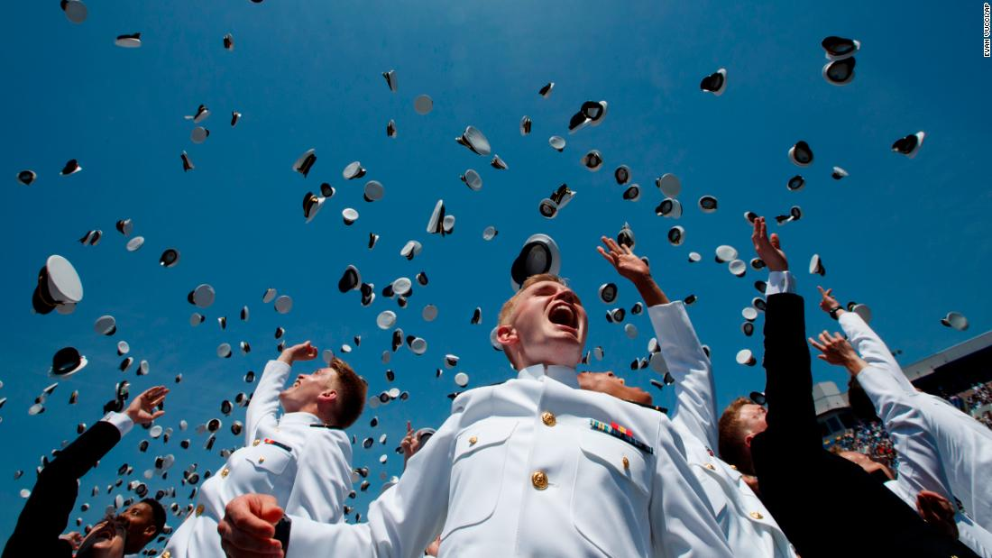 Midshipmen from the US Naval Academy throw their hats into the air during their graduation ceremony in Annapolis, Maryland, on Friday, May 25.