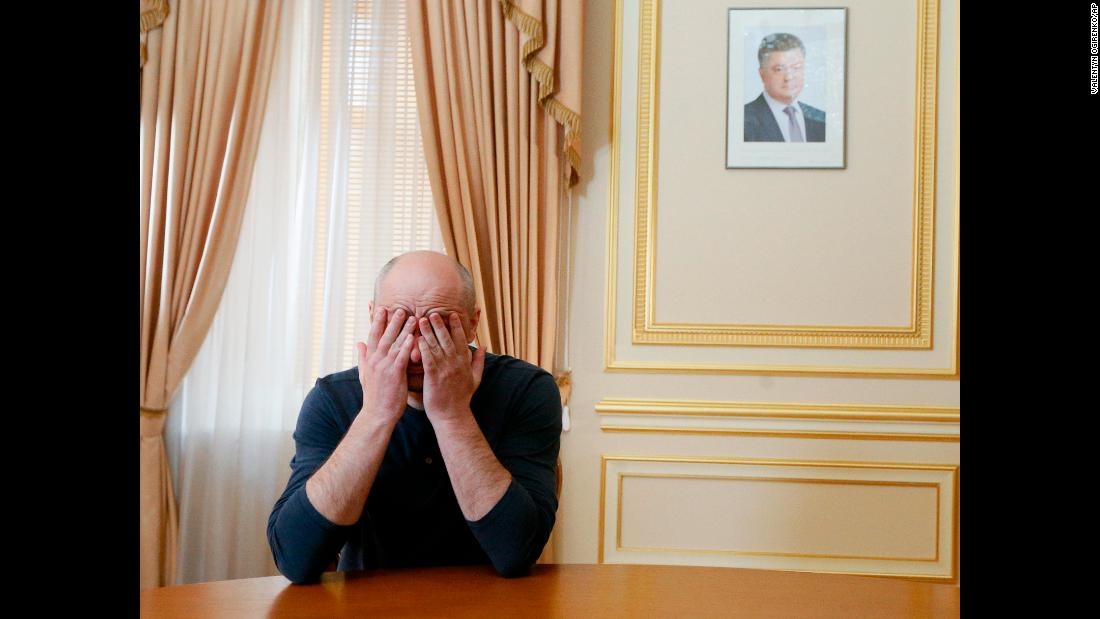 "Russian journalist Arkady Babchenko rubs his face during an interview with foreign media in Kiev, Ukraine, on Thursday, May 31. A day earlier, <a href=""https://www.cnn.com/2018/05/31/europe/russian-journalist-defends-staged-murder-intl/index.html"" target=""_blank"">he stunned observers</a> when he showed up alive at a news conference a day after his reported killing. He said that with the help of Ukrainian security services, he faked his death to foil an assassination plot against him."