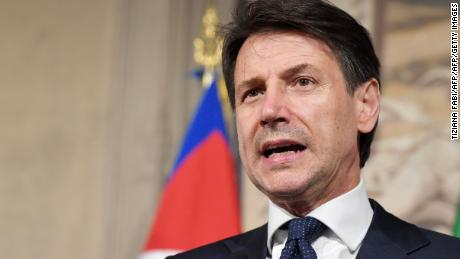 Italy's newly appointed Prime minister Giuseppe Conte announces the list of his government at the Quirinale presidential palace on May 31, 2018 in Rome after a meeting with Italian President. (Photo by Tiziana FABI / AFP)        (Photo credit should read TIZIANA FABI/AFP/Getty Images)