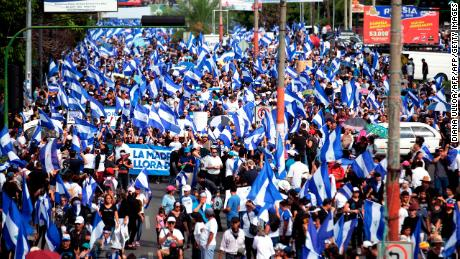 "Anti-government protesters take part in a march in support of ""the Mothers of April"" movement - whose children died in the protests - on Nicaragua's National Mothers Day, in Managua on May 30, 2018. - At least 87 people have been killed and almost 900 wounded since protests began on April 18 against Ortega and his party, the Sandinista National Liberation Front. (Photo by DIANA ULLOA / AFP)        (Photo credit should read DIANA ULLOA/AFP/Getty Images)"