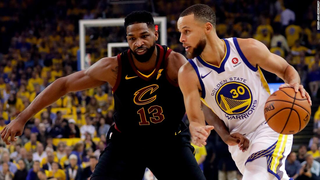 Curry drives past Tristan Thompson during the first quarter.
