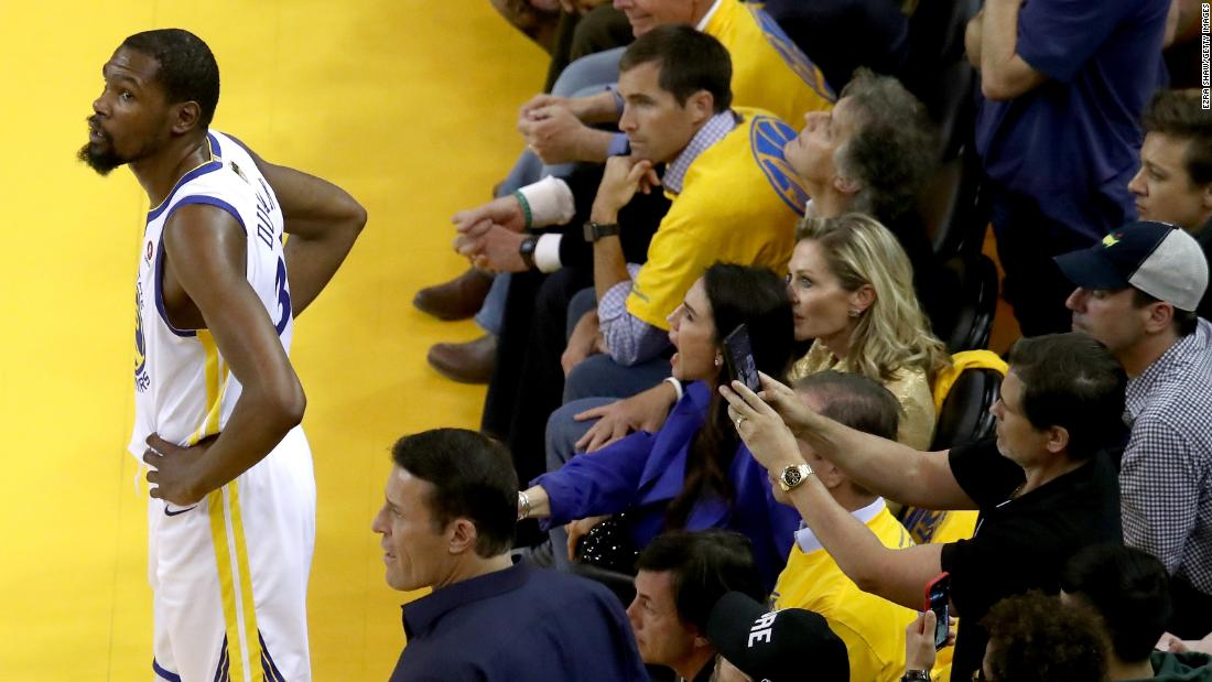 A fan gets a photo of Durant during a stoppage in play.
