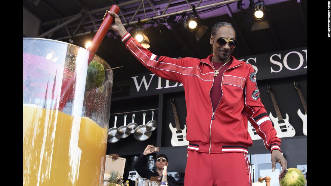 Rapper Snoop Dogg holds the straw of the world's largest cocktail -- a gin and juice made at the BottleRock Napa Valley music festival on Saturday, May 26. The drink, which is also the name of one of Snoop's most famous songs, was more than 132 gallons.