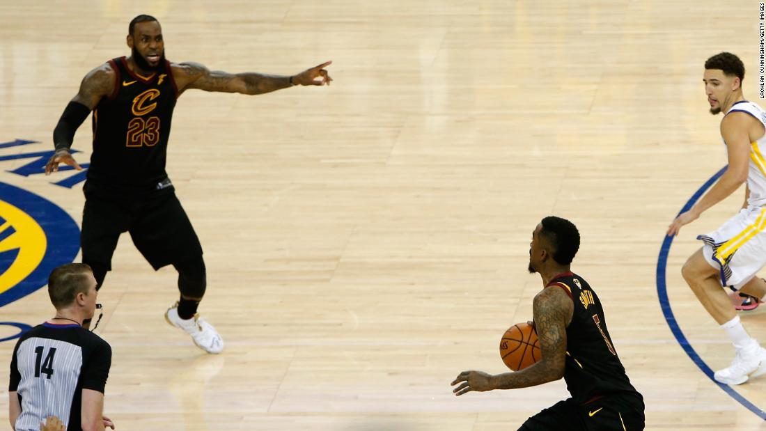 James tries to direct Smith back to the basket in the final seconds of regulation.
