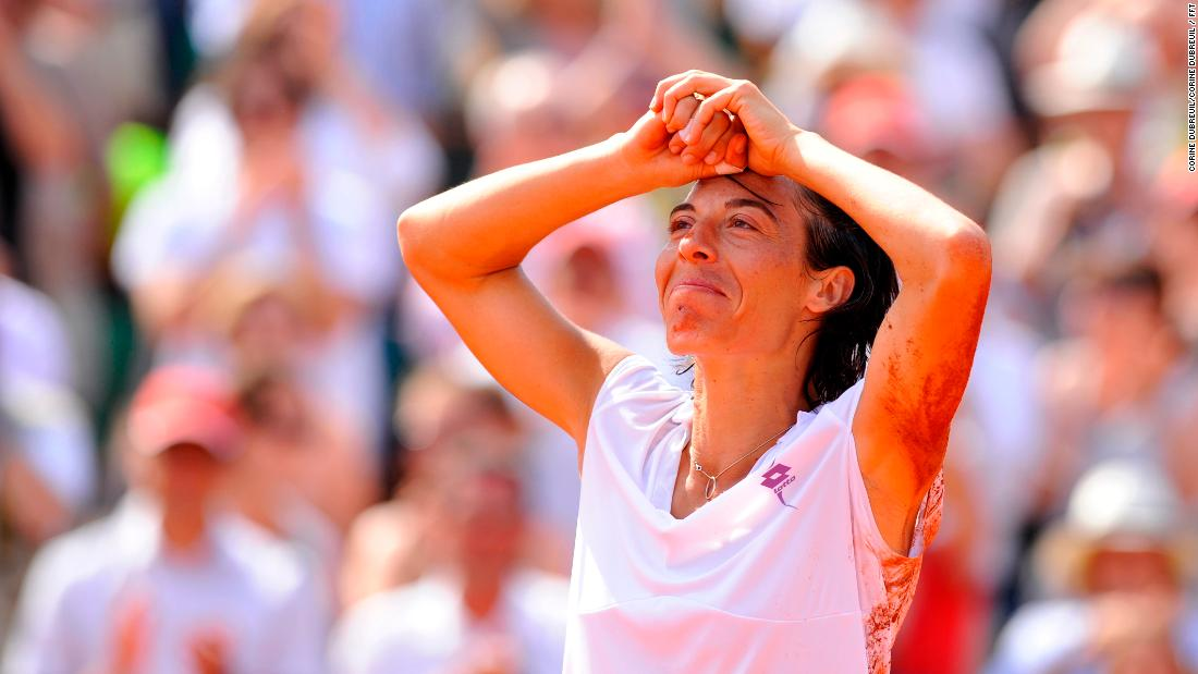 For Dubreuil, the expressive Italian Francesca Schiavone, seen here shortly after rolling on the clay after winning the 2010 French Open title, is a photographer's dream.