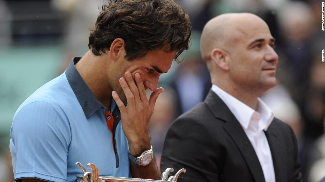 "One of Dubreuil's favorite photos is of a tearful Roger Federer, as he held the trophy after winning his only French Open title. ""I remember that final with Roger Federer against Robin Soderling,"" she recalls. ""It was very emotional, it was raining and Andre Agassi was there to give him the trophy. I remember the picture of Roger, he was standing in the rain with the trophy and then, when the Swiss anthem was playing, he started to cry. He was like a kid."""