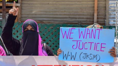 People in Srinagar hold a demonstration in May on the ninth anniversary of the rape and murder of Asiya and Neelofar Jan.