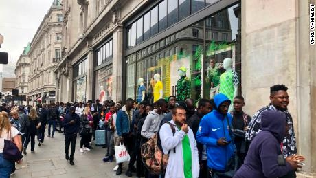 Football fans queue outside Nike store in Oxford, London for the newly released Nigerian kits designed by Nike for the 2018 World Cup on June 1, 2018.
