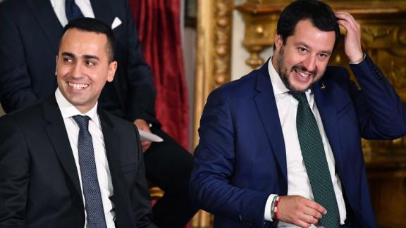 Luigi Di Maio (L) and Matteo Salvini (R) smile as they wait for the swearing in ceremony at the Quirinal.