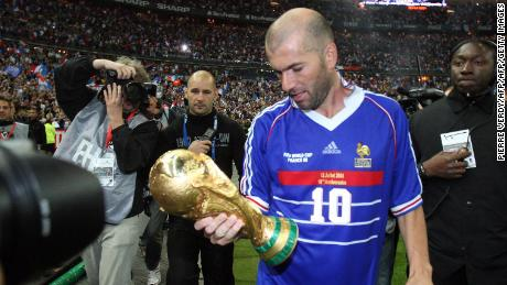 Zinedine Zidane celebrates with the World Cup trophy.