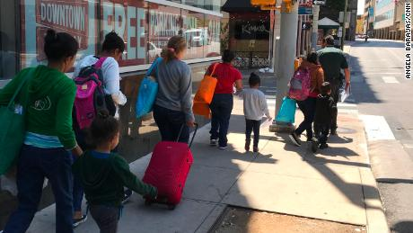 Undocumented women and their children being released from ICE custody walk to a bus station in San Antonio to continue their journey.  