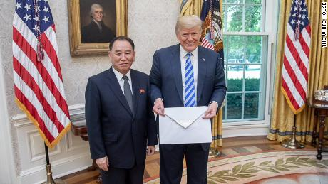 North Korean envoy Kim Yong Chol hands over a letter to Trump, purportedly from Kim.