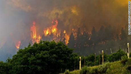 Thousands of acres ablaze in Colorado, New Mexico and California