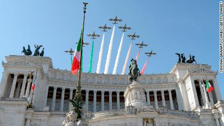 The Italian Special Air Force aerobatic unit 'Frecce Tricolori' spreads smoke with the colors of the Italian flag over the city of Rome during the ceremony for the anniversary of the Italian Republic (Republic Day),on June 2, 2018 in Rome Italy.