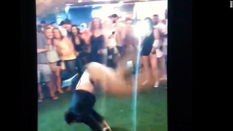 The off-duty law enforcement officer lost his gun as he performed a back handspring.