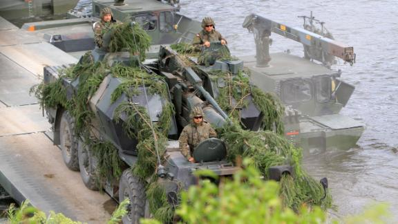 """NATO advance force battalion group (EFP) demonstrates a water obstacle crossing during an International exercise """"Iron Wolf 2017 /Saber Strike 2017"""