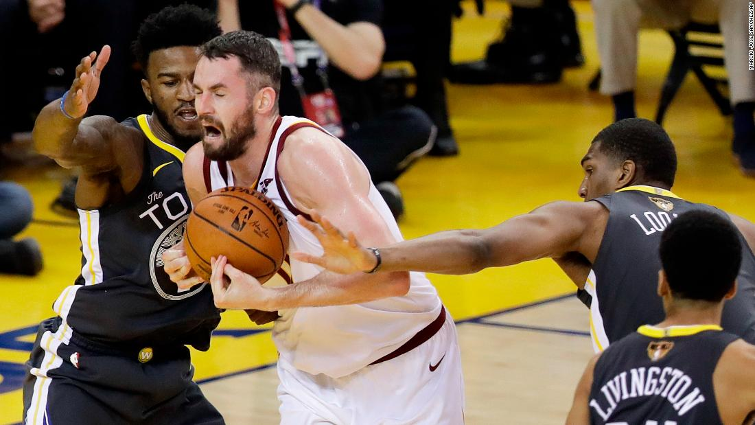 Love winces in the paint as he's defended in Game 2.