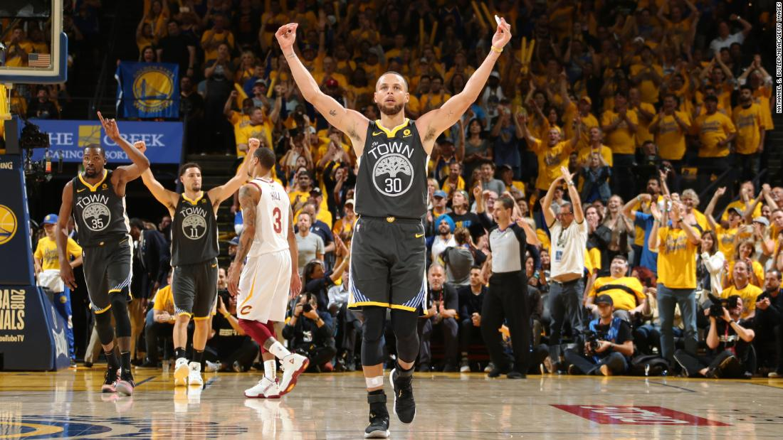 Curry celebrates as his team wraps up a Game 2 victory on Sunday, June 3. Curry hit a Finals-record nine 3-pointers as the Warriors won 122-103.