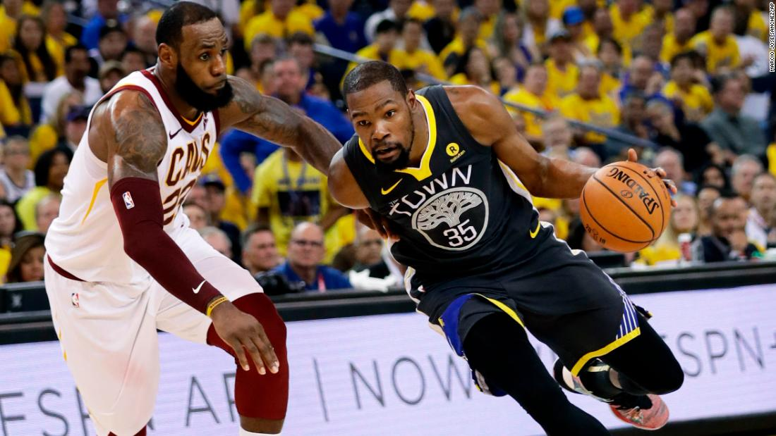Durant drives past James in the first half of Game 2.
