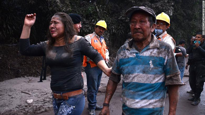 Residents flee El Rodeo village after the Fuego volcano's eruption Sunday.