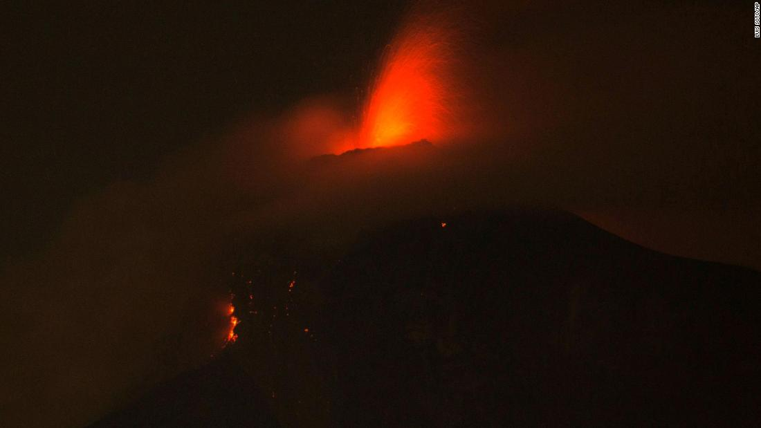 The volcano spews molten rock from its crater in Alotenango on Sunday, June 3.