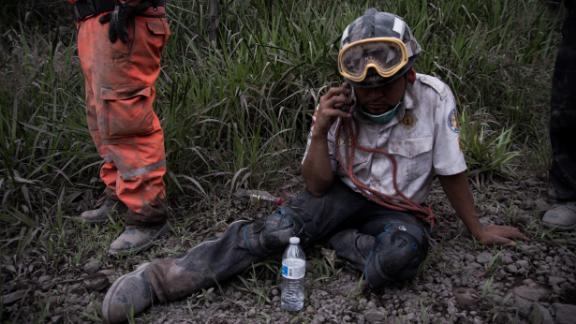A firefighter rests in the village of El Porvenir.