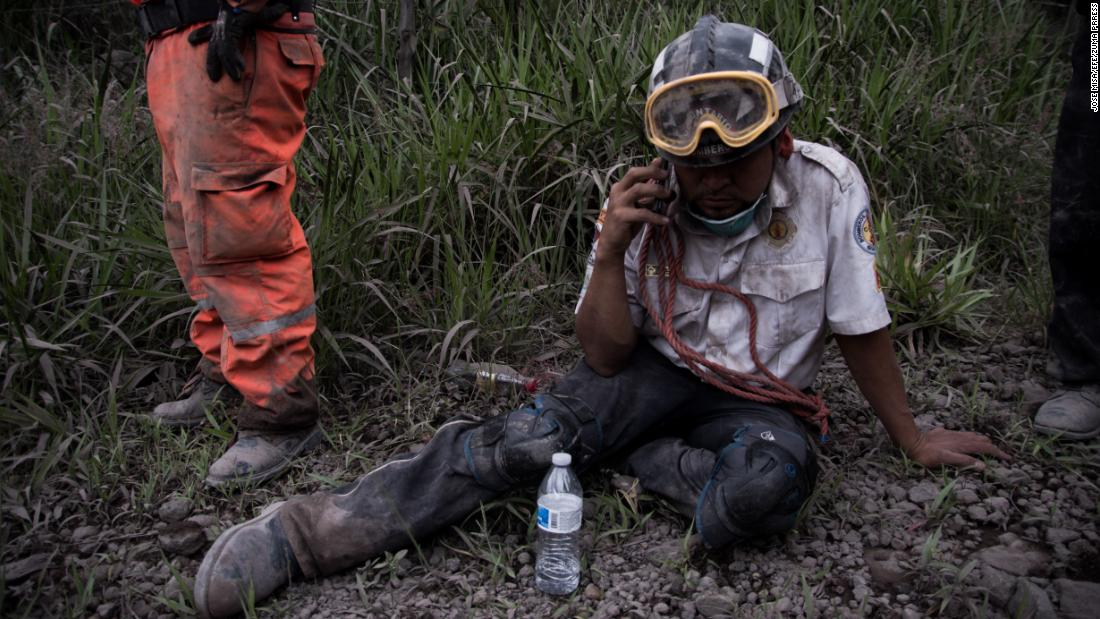 A firefighter rests in the village of El Porvenir.