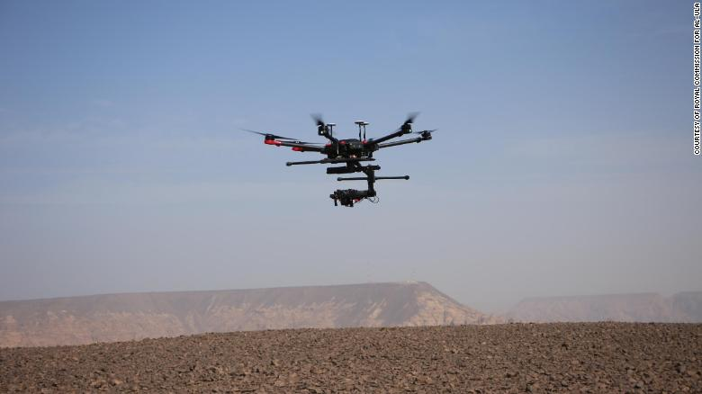 A drone takes photos of Al-Ula's archaeological sites.