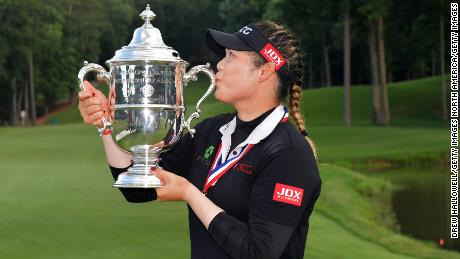 SHOAL CREEK, AL - JUNE 03:  Ariya Jutanugarn of Thailand kisses the trophy after winning  the 2018 U.S. Women's Open at Shoal Creek on June 3, 2018 in Shoal Creek, Alabama. (Photo by Drew Hallowell/Getty Images)