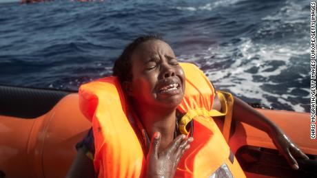 LAMPEDUSA, ITALY - MAY 24: A woman cries after losing her baby in the water as she sits in a rescue boat from the Migrant Offshore Aid Station (MOAS) 'Phoenix' vessel on May 24, 2017 off Lampedusa, Italy. The Migrant Offshore Aid Station (MOAS) 'Phoenix' vessel rescued 603 people after one of three wooden boats partially capsized leaving more than 30 people dead. Numbers of refugees and migrants attempting the dangerous central Mediterranean crossing from Libya to Italy has risen since the same time last year with more than 43,000 people recorded so far in 2017. In an attempt to slow the flow of migrants Italy recently signed a deal with Libya, Chad and Niger outlining a plan to increase border controls and add new reception centers in the African nations, which are key transit points for migrants heading to Italy. MOAS is a Malta based NGO dedicated to providing professional search-and-rescue assistance to refugees and migrants in distress at sea. Since the start of the year MOAS have rescued and assisted 3572 people and are currently patrolling and running rescue operations in international waters off the coast of Libya.  (Photo by Chris McGrath/Getty Images)