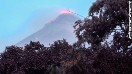Volcanic activity at Fuego is visible Monday in Los Lotes, south of Guatemala City.