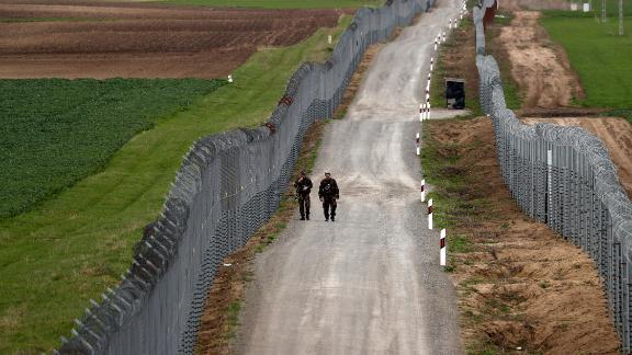 Hungarian soldiers patrol the border with Serbia in April 2018.