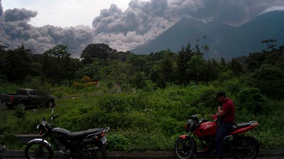 Volcan de Fuego, or Volcano of Fire, blows outs a thick cloud of ash, as seen from Alotenango, Guatemala, Sunday, June 3, 2018. One of Central America